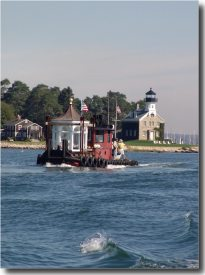 The lantern rides aboard the Chief  as it passes Morgan Point Lighthouse.