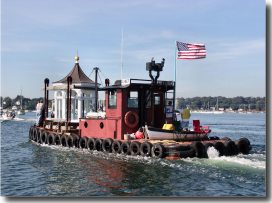 The tug Chief transports the new lantern for Avery Point down the Mystic River (Photo by Ron Foster)