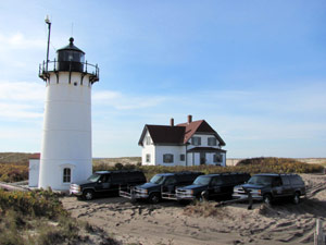 Race Point Light and the fleet of Suburbans