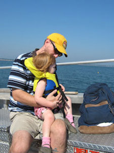 "Damian and Aryana aboard ""Lightrunner"" in route to Wood Island on 9/2/10 (Photo by Sheri Poftak)"
