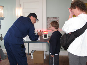 Auxiliarist Bob Trapani, Jr. explains to a younger visitor how a light emitting diode (LED) beacon works (Photo by Dominic Trapani)