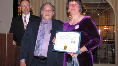 Lynne Kerber of the New England Lighthouse Lovers is Presented with an ALF Volunteer Award
