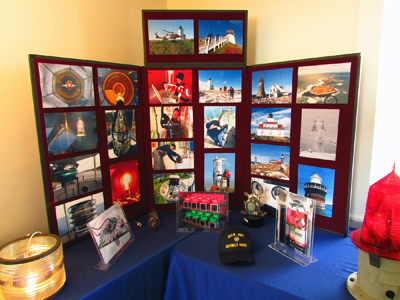 In addition to modern beacons, the Coast Guard exhibit also included imagery showing various facets of the USCG's work to keep the lights shining today. (Photo by Bob Trapani, Jr.)