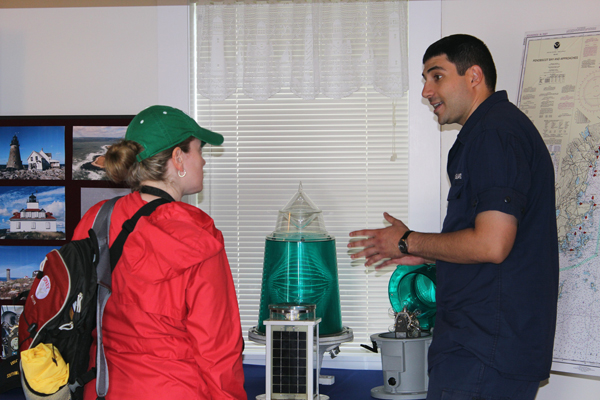 SN Sami Jasser talks with a visitor about how the Coast Guard keeps the lights shining bright today in the 21st century. (Photo by Ann-Marie Trapani)