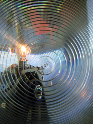 A brighter lamp shines it light through the Fresnel profile lens panel of the VRB-25 rotating beacon at Little River Lighthouse (Photo by Bob Trapani, Jr.)
