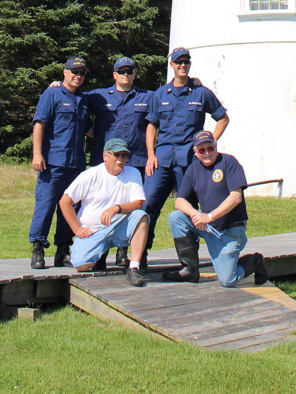 (Standing L to R) Auxiliarist Bob Trapani, Jr., EM1 Steven Horner and EM1 Derek Stewart (Front L to R) Terry Rowden and Timothy Harrison of ALF's Friends of Little River Lighthouse on July 18, 2013 (Photo by Ann Trapani)