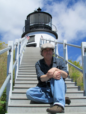 Musician John Mock at Maine's Owls Head Lighthouse (Photo by Bob Trapani, Jr.)