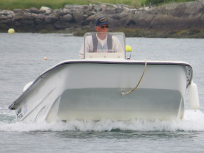 Terry Rowden making a run to the island with FLRL's 17-foot Carolina skiff (Photo by Bob Trapani, Jr.)