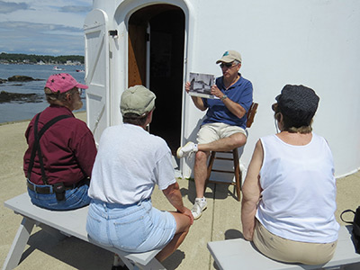 FPHL volunteer Dave Garabedian shares some lighthouse history with visitors during an open house at Portsmouth Harbor Lighthouse. (Photo by Bob Trapani, Jr.)