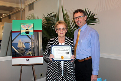 "ALF President Eric Davis presents Cynthia Rowden of the Friends of Little River Lighthouse with ALF's ""Len Hadley Volunteerism Award."" (Photo by Dominic Trapani)"