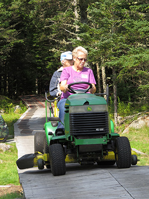 Cynthia Rowden transporting a guest to the lighthouse during an open house. (Photo by Bob Trapani, Jr.)