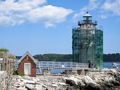 Lighthouse being repainted.